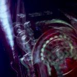Galerie Ahlemann zeigt ein abstraktes Foto von Ralf Lindenau in der Kategorie Abstraktes, welches mechanisch-technisch wirkende Gegenstände in hellen Farbtönen vor dunklem Hintergrund darstellt.