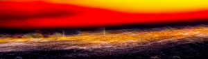 Galerie Ahlemann zeigt ein abstraktes Foto von Ralf Lindenau in der Kategorie Wahnfarben in überwiegend gelben und rötlichen Farbtönen, im Querformat